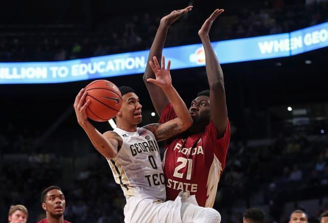 FSU center Christ Koumadje tries to affect a shot from Georgia Tech's Josh Moore.