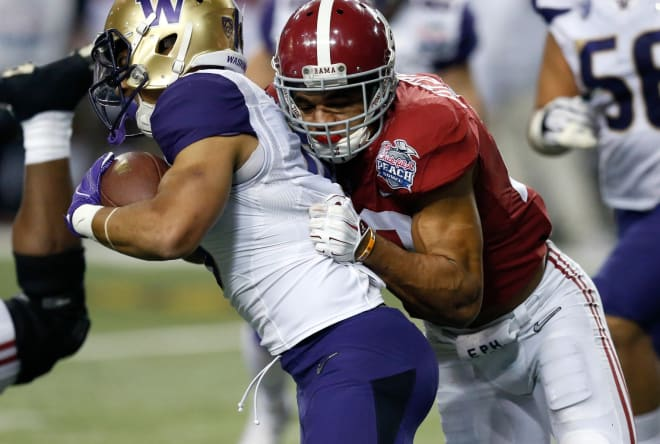 Alabama Crimson Tide defensive back Minkah Fitzpatrick (29) tackles Washington Huskies running back Myles Gaskin (9) for a short gain during the fourth quarter in the 2016 CFP Semifinal at the Georgia Dome.