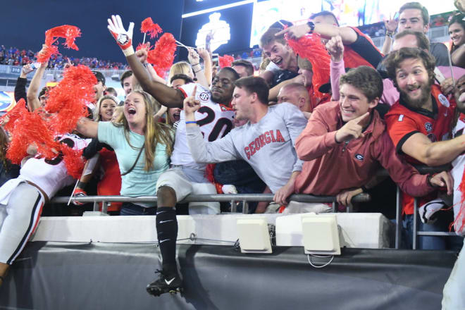 J.R. Reed celebrates Georgia's win with fans.