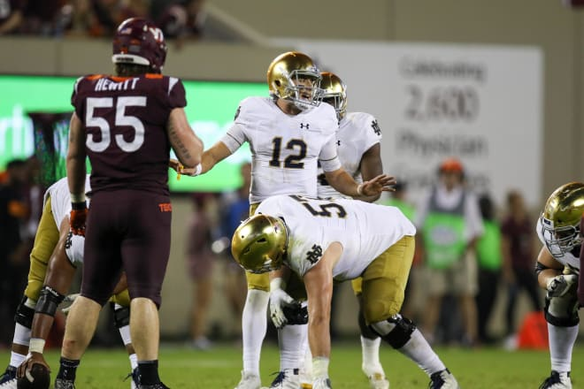 Notre Dame senior quarterback Ian Book completed only 8 of 25 passes for 73 yards in the 45-14 loss at Michigan on Saturday, making him a popular topic at Brian Kelly's Monday press conference.