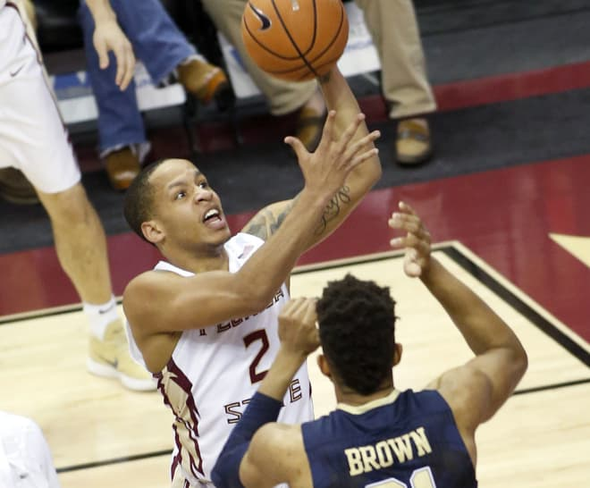 C.J. Walker drives to the basket in the first half of Sunday night's game against Pitt.