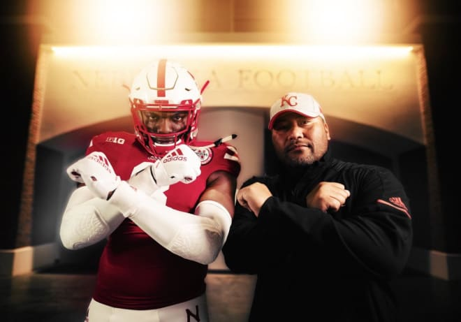 Perrion Winfrey and Husker defensive line coach Tony Tuioti.