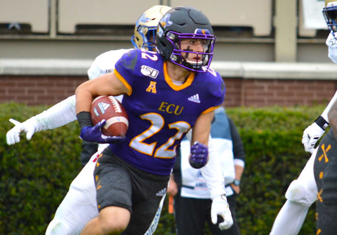 ECU wide receiver Tyler Snead advances the football in a 49-24 loss to Tulsa for Senior Day on Saturday.