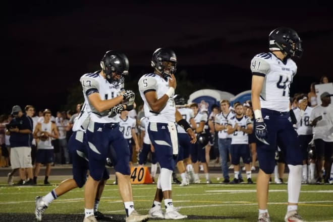 Ironwood Ridge juniors FB Luca Moioli (left), QB Octavio Audry-Cobos (center), and TE Ryan Lukasik-Drescher (right) approach the line of scrimmage in a road game from last August.  (Photo by Ralph Amsden)