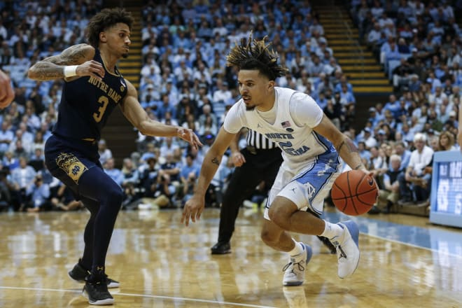 Notre Dame guard Prentiss Hubb (left) had a career-high 22 points but it wasn't enough to outdo North Carolina freshman Cole Anthony;s  34-point effort.