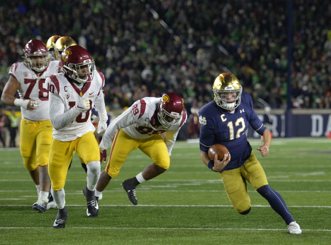 Notre Dame quarterback Ian Book scrambled for 49 yards Saturday as partof the Fighting Irish's 308 total rushing yards vs. USC.