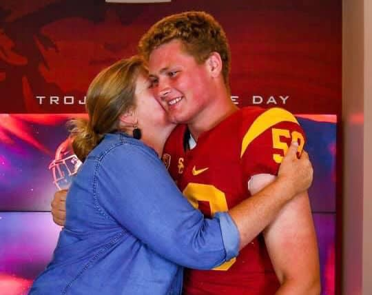 2020 DL/OL prospect Kyle Juergens (St. Margaret's School/San Juan Capistrano) celebrates his USC offer Wednesday with his mother Celeste Shoemaker-Marshall. (Photo courtesy of Kyle Juergens)