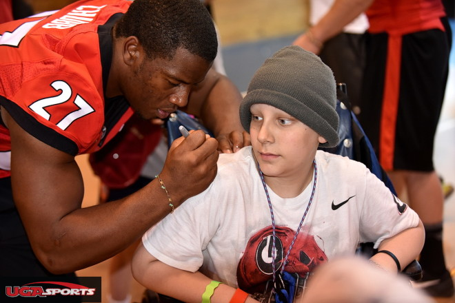 "Nick Chubb was asked by this camper, ""Do you need my brace?"" Chubb smiled and said, ""No, I'm good."""