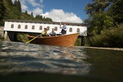 Drift Boat on the McKenzie River in front of Goodpasture Covered Bridge