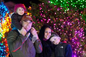 Mother, Father and two sons enjoy Zoolights at Point Defiance Zoo
