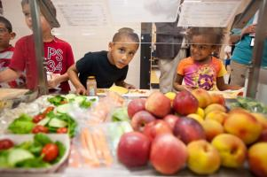 Kids look at healthy food choices
