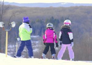Family skiing at Nemacolin Woodlands Resort in Laurel Highlands