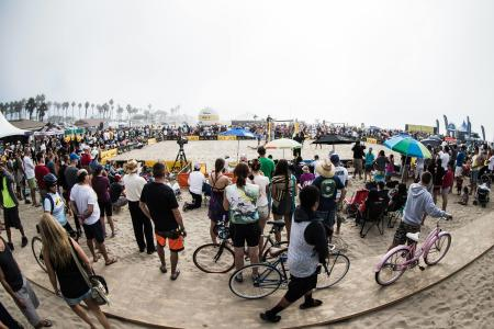 Fans gather around the court to watch the AVP Championships by the Huntington Beach Pier (Photo courtesy of the Association of Volleyball Professionals)
