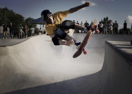 Skateboarder doing tricks in a halfpipe