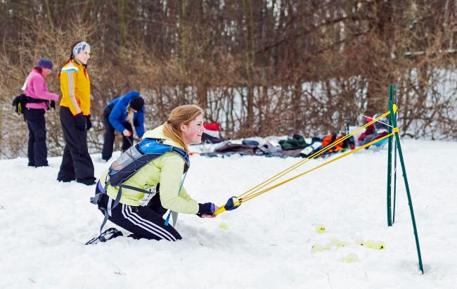 Woman using catapult at Winter Adventure Race