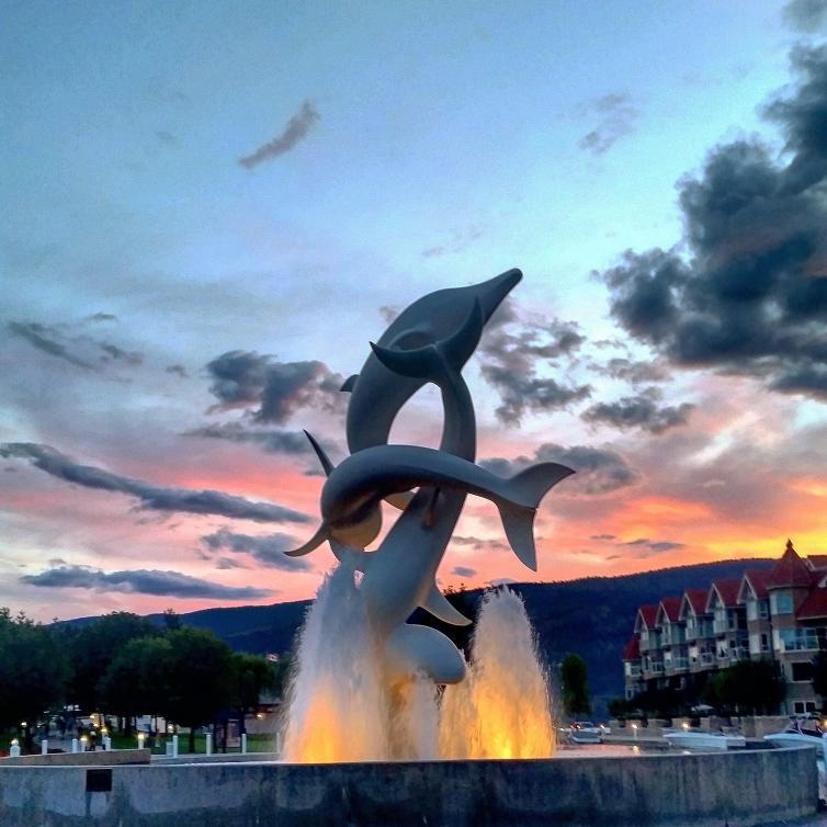 Sunset Dolphin Statue