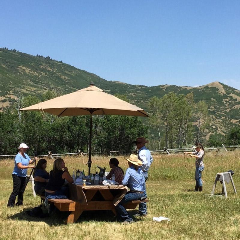 A group prepares for a horseback ride in the hills of Park City