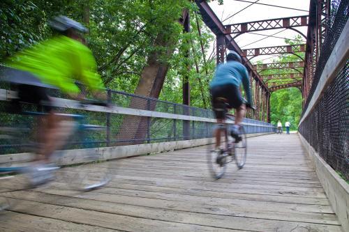 Biking in Grand Rapids across bridge