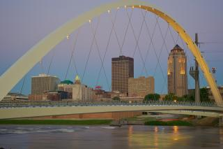 Iowa Women of Achievement Bridge wth downtown skyline at sunrise