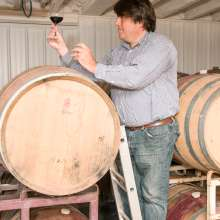 Ravines Wine Cellars winemaker and co-owner, Morten Hallgren testing wine