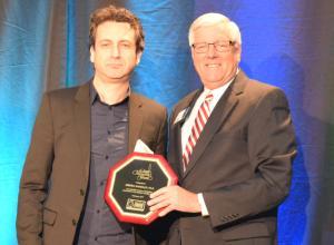Andrea Shindler, Ph. D. accepts Community Champion Award