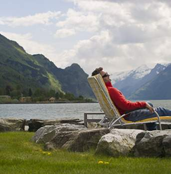 Man relaxing outside Hotel Ullensvang