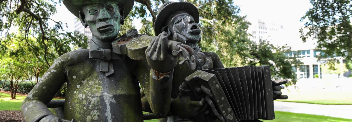 Bronze statue of musicians in park