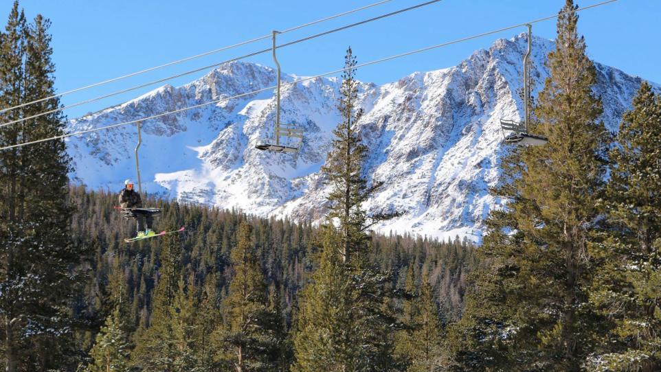 June Mountain skier on lift