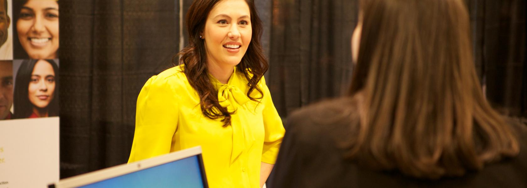 Lady in Yellow at Trade Show Booth