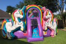Unicorn bounce house rental entrance