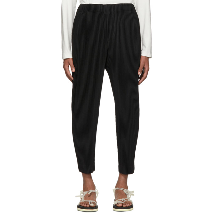 Black Pleated Tapered Trousers by Homme PlissÉ Issey Miyake
