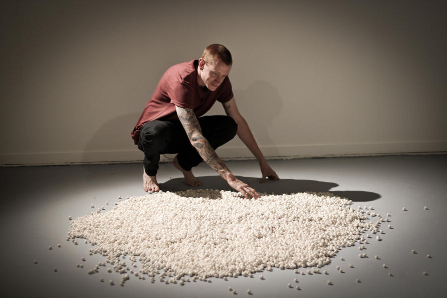 One Drop of Blood, Dan Elborn. The artist has made 20,000 pebble-sized porcelain white blood cells, which viewers are invited to take as a representation of the falling white blood cell count of cancer patients undergoing chemotherapy. Image: Dan Tupos