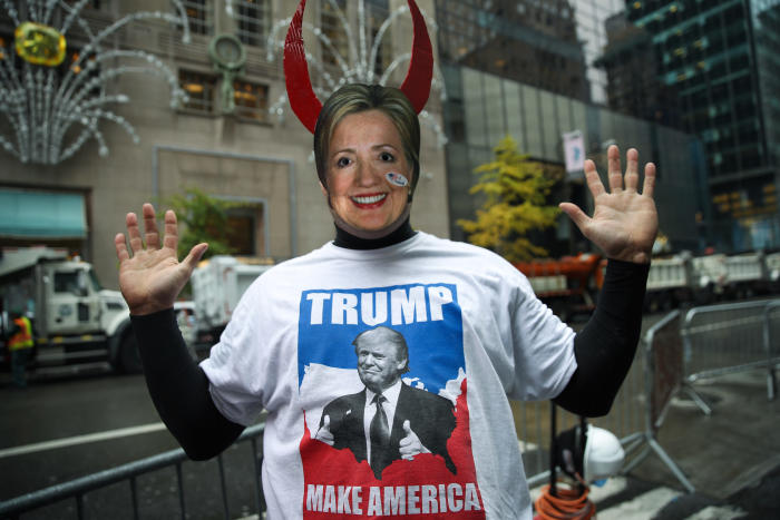 A Donald Trump supporter wears a Hillary Clinton mask outside Trump Tower in New York City the morning after the election. Picture: Drew Angerer/Getty Images