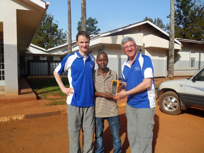 Associate Professor Rassool and Dr Sobott with Jinja, a potential technician, assisting in field trials. Picture supplied