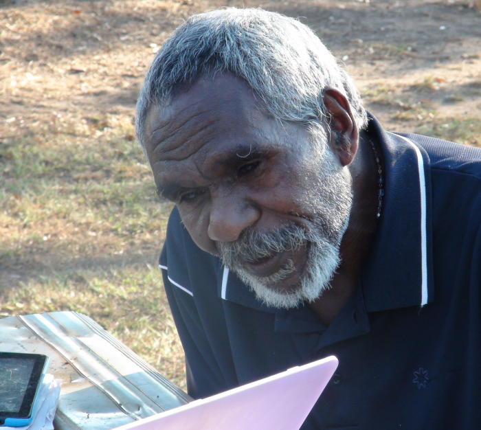 Damien Tunmuck listening to a recording Dr Green made in 1990 of his late father Johnny Chula speaking the Magati Ke language, of which there are no fluent speakers left. Picture: Associate Professor Rachel Nordlinger.