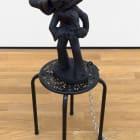 Brian Kokoska, Lonesome Cowboy (Dead Elvis), 2016, ceramic, rubber mask, acrylic, plastic, metal table, lock, double bit axe, cable tie, dimensions variable