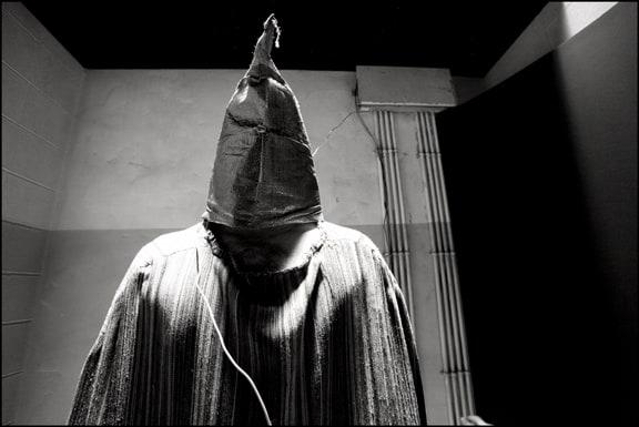Hooded Prisoner on a Box- Reenactment