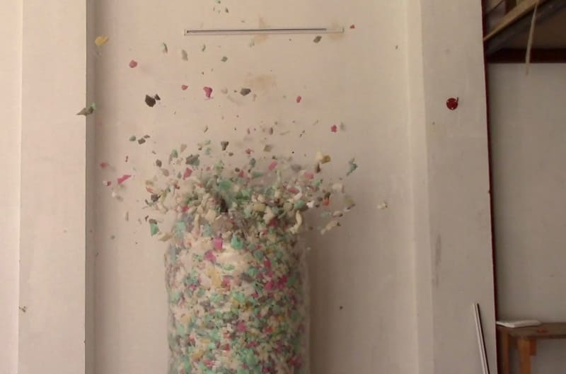 Shredded foam filling and firecrackers, video still.