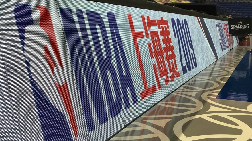 Workers forced to re-sand floors for NBA game in China after sponsors pulled out