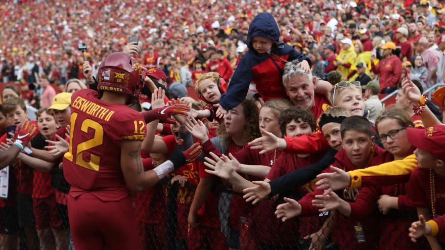 Watch: Fans rush field during Iowa vs. Iowa State weather delay