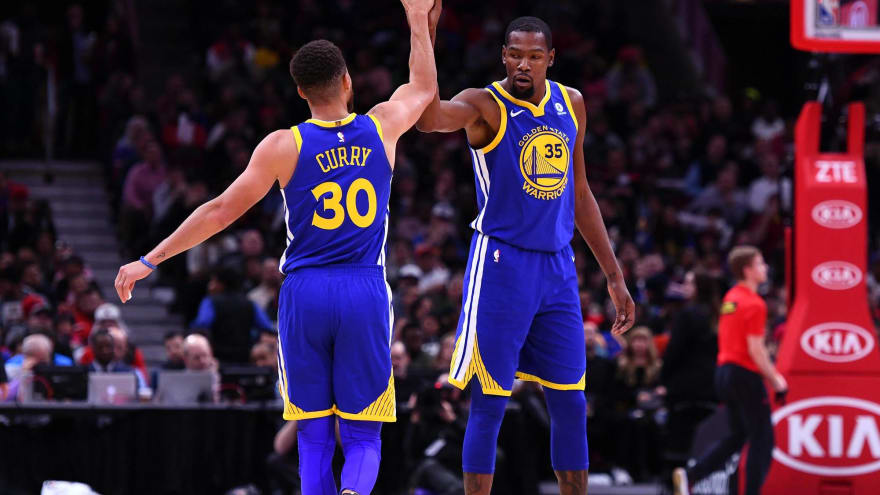 Jan 17, 2018; Chicago, IL, USA; Golden State Warriors guard Stephen Curry (30) reacts with forward Kevin Durant (35) after making a three point basket ...