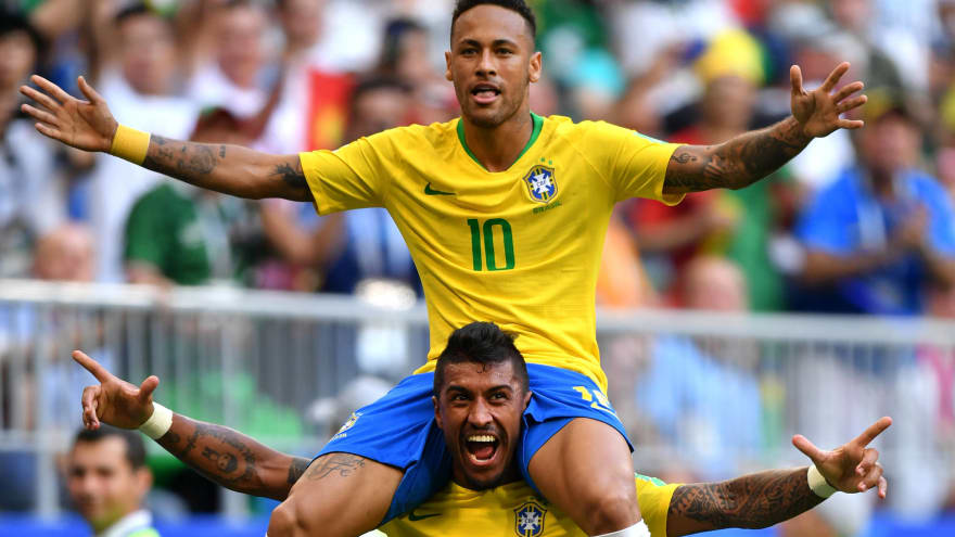 0c42c7b73 Neymar of Brazil celebrates with teammate Paulinho after scoring his team s  first goal during the 2018 FIFA World Cup Russia Round of 16 match between  ...